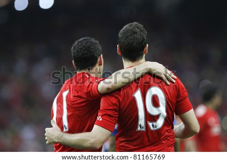 KUALA LUMPUR - JULY 16 : Liverpool football club Maxi Rodriguez (L) and Alberto Aquilani at a friendly match against Malaysia XI on July 16, 2011 in Kuala Lumpur, Malaysia. Liverpool won 6-3. - stock photo
