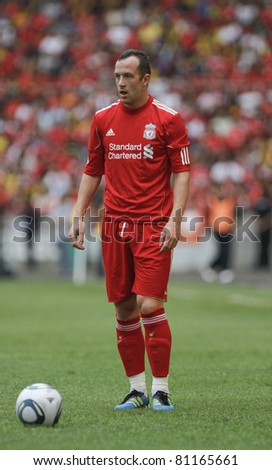 KUALA LUMPUR - JULY 16 : Liverpool football club player Charlie Adam ready to kick a ball during a friendly match against Malaysia XI on July 16, 2011 in Kuala Lumpur, Malaysia. Liverpool won 6-3. - stock photo