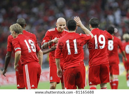 KUALA LUMPUR - JULY 16 : Liverpool football club players celebrate a goal at a friendly match against Malaysia XI on July 16, 2011 in Kuala Lumpur, Malaysia. Liverpool won 6-3.