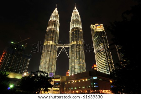 KUALA LUMPUR - JULY 14: The Petronas Twin Towers on July 14, 2010 in Kuala Lumpur, Malaysia were the tallest buildings from 1998 to 2004 in the world, their height was surpassed by Taipei 101. - stock photo