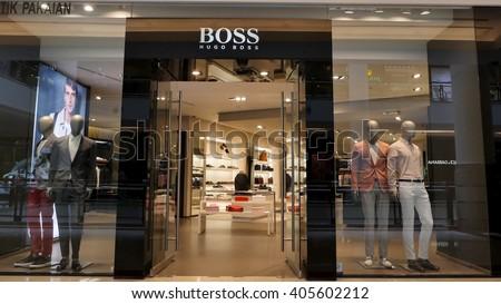 KUALA LUMPUR, MALAYSIA - April 10, 2016. Hugo Boss store inside Suria KLCC. Hugo Boss is a major German luxury fashion company. Founded in Metzingen, Germany since 1924. - stock photo