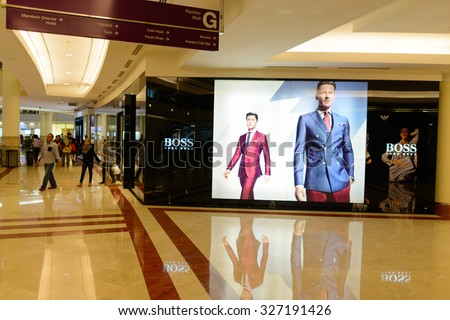 KUALA LUMPUR, MALAYSIA - APRIL 23, 2014: Suria KLCC shopping mall in Petronas Twin Towers. Suria KLCC is one of the largest shopping malls in Malaysia - stock photo