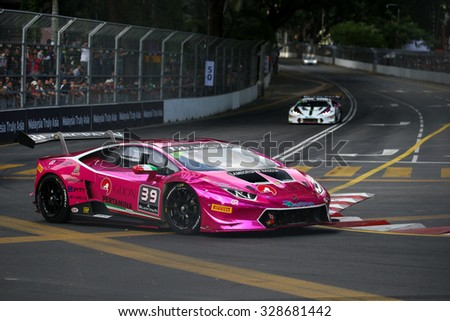 KUALA LUMPUR, MALAYSIA - AUGUST 09, 2015: Akira Mizutami in a Lamborghini Super Trofeo LP620 races in the Lamborghini Blancpain Super Trofeo Race at the 2015 Kuala Lumpur City Grand Prix. - stock photo