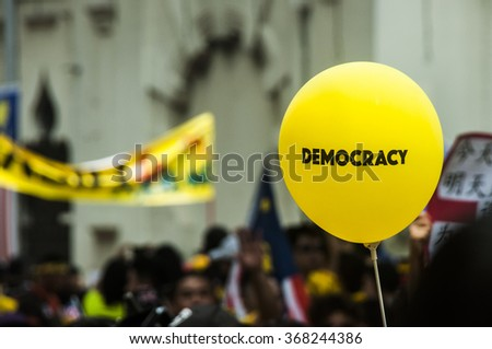 KUALA LUMPUR, MALAYSIA - AUGUST 30, 2015 : BERSIH 4 rally held in Kuala Lumpur City. A democracy balloon during is in the focus with bokeh background.  - stock photo