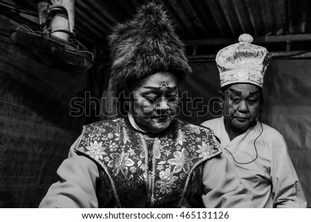 KUALA LUMPUR, MALAYSIA - AUGUST 06:  Chinese operas actor and actress prepare at public makeshift theather during the Hungry Ghost Festival in Petaling Street, Kuala Lumpur.