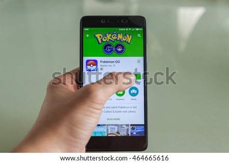 "Kuala Lumpur, Malaysia - August 6, 2016 : Close of a person holding a smartphone installing Pokemon Go game. On the screen showed a person press on ""Install"" of Pokemon Go game application"