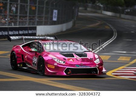 KUALA LUMPUR, MALAYSIA - AUGUST 08, 2015: Naoki Yokomizo drives a Lamborghini Huracan Super Trofeo LP620 car on the city streets in the KL City GT CUP Race of the 2015 Kuala Lumpur City Grand Prix. - stock photo