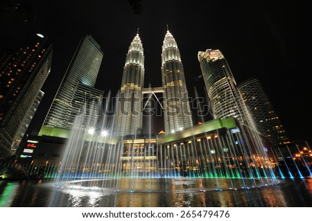 KUALA LUMPUR, MALAYSIA - AUGUST 31: Petronas Twin Towers at night on August 31, 2012 in Kuala Lumpur. Petronas Twin Towers  were the tallest buildings (452 m) in the world from 1998 to 2004. - stock photo