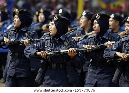 KUALA LUMPUR, MALAYSIA - AUGUST 31: Royal Malaysian Police personnels take part during the Independence Day celebration in Kuala Lumpur, Malaysia, 31 August 2013.  - stock photo