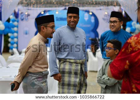 KUALA LUMPUR, MALAYSIA - AUGUST 15TH 2015.  Malaysian of different races bonding together during Hari Raya open house in Kuala Lumpur. Celebrations in Malaysia are not restricted by race or religion.