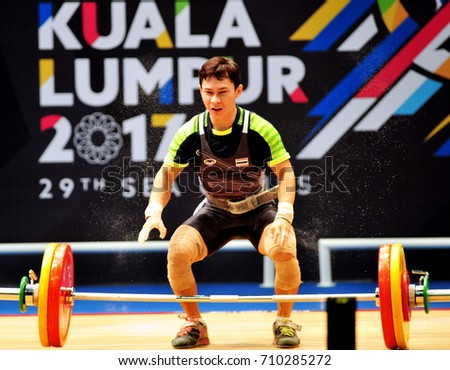 KUALA LUMPUR, MALAYSIA, AUGUST 28, 2017: Weightlifting athletes are in action at the 29th SEA Games at the Malaysia International Trade and Exhibition Center (MiTEC) Kuala Lumpur.