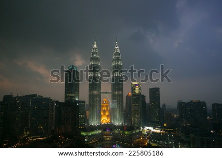 KUALA LUMPUR, MALAYSIA - CIRCA FEB 2014: Nightscape of Petronas Twin Towers. Petronas Twin Towers were the tallest buildings (452m) in the world during 1998-2004.