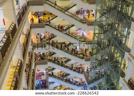 KUALA LUMPUR, MALAYSIA - CIRCA JUNE 2014: People in the Berjaya Time Square shopping complex. Berjaya Time Square is the most popular shopping destination in Malaysia.