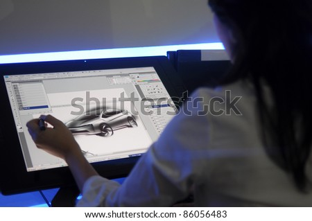 KUALA LUMPUR, MALAYSIA - DEC 3: An unidentified artist showcases a digital sketching of a concept car during Kuala Lumpur International Motor Show on December 8, 2010 in Kuala Lumpur Malaysia.
