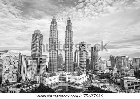 KUALA LUMPUR, MALAYSIA - DECEMBER 28: Black and white image of the Kuala Lumpur skyline. Photo taken December 28, 2013 in Kuala Lumpur, Malaysia. - stock photo