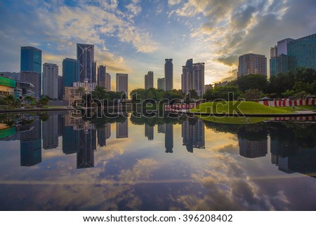 KUALA LUMPUR,MALAYSIA-DECEMBER 21 2015:Commercial buildings view from KLCC Symphony Lake.  The image may contains noise and blurry efffets due to long exposure