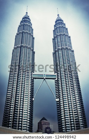 KUALA LUMPUR, MALAYSIA - DECEMBER 20: Petronas Twin Towers on December 20, 2010 in Kuala Lumpur, Malaysia. Petronas Towers are twin skyscrapers and were tallest buildings in the world until 2004 - stock photo