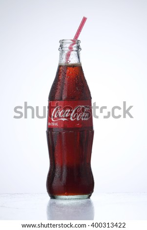 KUALA LUMPUR, MALAYSIA - Feb 17, 2016  cold coca cola bottle with straw on the white background - stock photo