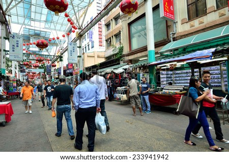 Kuala Lumpur,Malaysia - February 16, 2014 : Petaling Street is a china town which is located in Kuala Lumpur,Malaysia.It usually crowded with locals as well as tourists. - stock photo