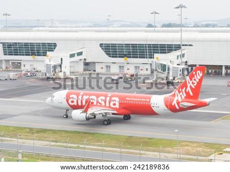 Kuala Lumpur, Malaysia - January 5, 2015. Aircraft of Air asia preparing to take off at Kuala Lumpur International Airport on Jan 5, 2015 - stock photo