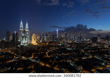 KUALA LUMPUR, MALAYSIA -  JANUARY 9, 2016: Blue hour view on on the cityscape around the Petronas Twin Towers. The most popular tourist destination in Malaysian capital