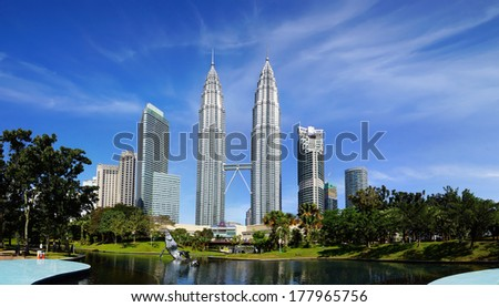 KUALA LUMPUR, MALAYSIA - JANUARY 31: Petronas Towers on January 31, 2014 in Kuala Lumpur, Malaysia.Petronas Towers,also known as Menara Petronas is the tallest buildings in the world from 1998 to 2004 - stock photo