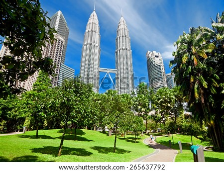 KUALA LUMPUR, MALAYSIA - JANUARY 11: Petronas Twin Towers at day on January 11, 2014 in Kuala Lumpur. Petronas Twin Towers were the tallest buildings (452 m) in the world from 1998 to 2004 - stock photo