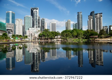 Kuala Lumpur, Malaysia - January 30, 2016: The KL City Centre Park in Kuala Lumpur, Malaysia. View on modern skyscrappers.
