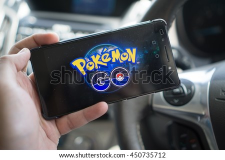KUALA LUMPUR, MALAYSIA - JULY 9TH, 2016 : An Android user plays Pokemon Go in a car, a free-to-play augmented reality mobile game developed by Niantic for iOS and Android devices.