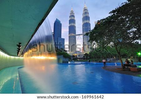 KUALA LUMPUR, MALAYSIA - JULY 30: The Petronas Twin Towers on July 30, 2011 in Kuala Lumpur, Malaysia. The skyscraper (451.9m/88 floors) is the tallest twin buildings in the world.  - stock photo