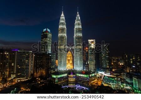 KUALA LUMPUR, MALAYSIA June 10, 2014: Dusk is falling over the Petronas Towers - stock photo