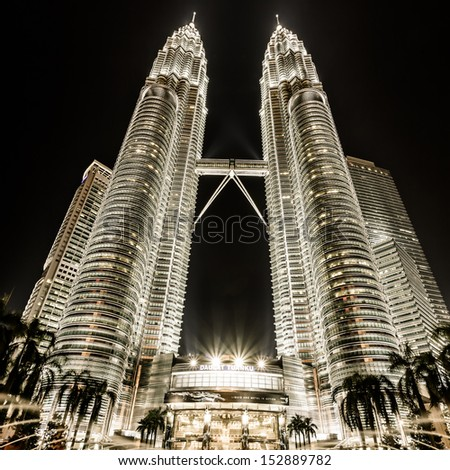 KUALA LUMPUR, MALAYSIA - JUNE 14: Petronas Twin Towers on June 14, 2013 in Kuala Lumpur, Malaysia. Petronas Towers are twin skyscrapers and were tallest buildings in the world until 2004  - stock photo