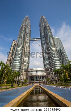 KUALA LUMPUR, MALAYSIA - June 25: Petronas Twin Towers on June 25, 2015 in Kuala Lumpur, Malaysia. Petronas Towers are twin skyscrapers and were tallest buildings in the world until 2004