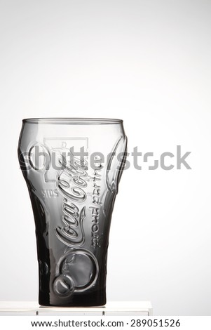 KUALA LUMPUR, MALAYSIA - june 6TH, 2015. A empty glass of coca cola. Coca Cola drinks are produced and manufactured by The Coca-Cola Company, an American multinational beverage corporation