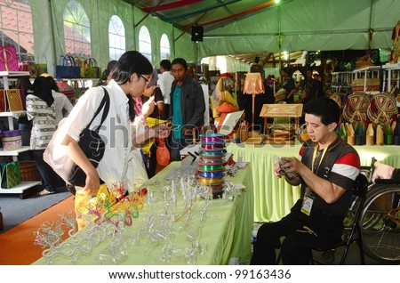 KUALA LUMPUR, MALAYSIA - MARCH 30: Demonstration of unique product designs by people with disabilities during National Craft Day 2012 at the Kuala Lumpur Craft Complex on March 30,2012 in Kuala Lumpur - stock photo