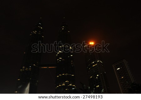 KUALA LUMPUR,MALAYSIA - MARCH 28: Earth Hour - Light Off at Petronas Twin Tower on March 28, 2009. It is organized by WWF aims to raise awareness towards the need to take action on climate change. - stock photo