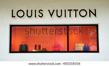 KUALA LUMPUR, MALAYSIA - March 31, 2016. Louis Vuitton product display in glass wall in Kuala Lumpur. Louis Vuitton is a France luxury leather goods company. Founded in Paris, France since 1854. - stock photo