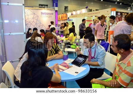 KUALA LUMPUR, MALAYSIA - MARCH 17: Reliance College promote the exhibition during the Falcon Education Fair 2012 at Kuala Lumpur Convention Centre (KLCC) March 17, 2012 in Kuala Lumpur. - stock photo