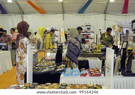 KUALA LUMPUR, MALAYSIA - MARCH 30: Souvenir items sold by exhibitors showcase during National Craft Day 2012 at the Kuala Lumpur Craft Complex on March 30, 2012 in Kuala Lumpur, Malaysia - stock photo