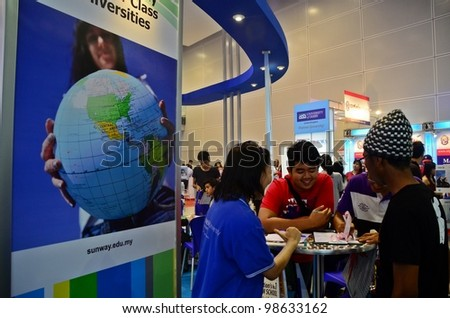 KUALA LUMPUR, MALAYSIA - MARCH 17: Sunway University  promote the exhibition during the Falcon Education Fair 2012 at Kuala Lumpur Convention Centre (KLCC) March 17, 2012 in Kuala Lumpur. - stock photo
