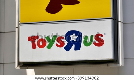 """KUALA LUMPUR, MALAYSIA - March 31, 2016. Toys R Us sign display on wall in center of Kuala Lumpur. Toys """"R"""" Us, Inc. is an American toy products retailer founded in 1948 in Wayne, New Jersey. - stock photo"""