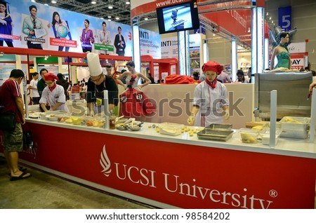 KUALA LUMPUR, MALAYSIA - MARCH 17: University of USCI promote the exhibition during the Falcon Education Fair 2012 at Kuala Lumpur Convention Centre (KLCC) March 17, 2010 in Kuala Lumpur. - stock photo