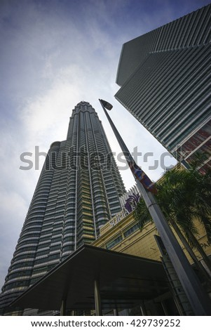 KUALA LUMPUR, MALAYSIA - MAY 31, 2015: Cloudscape view of the Petronas Twin Towers at KLCC City Center. The most popular tourist destination in Malaysian capital
