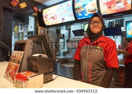 KUALA LUMPUR, MALAYSIA - MAY 09, 2016: interior of McDonald's. McDonald's is the world's largest chain of hamburger fast food restaurants. - stock photo
