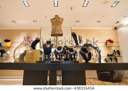 KUALA LUMPUR, MALAYSIA - MAY 09, 2016: interior of the store at Suria KLCC. Suria KLCC is a shopping mall is located in the Kuala Lumpur City Centre district. - stock photo