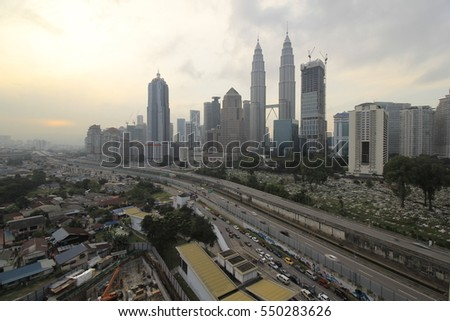 KUALA LUMPUR, MALAYSIA-MAY 3 2016:The Petronas Twin Tower and its surrounding buildings