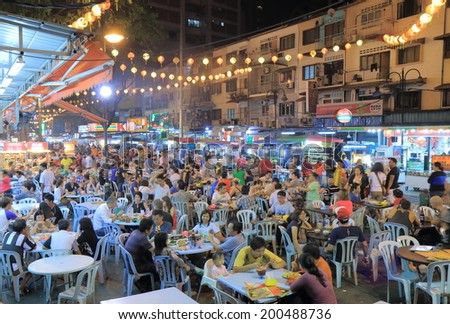 KUALA LUMPUR MALAYSIA - 26 May, 2014: Unidentified people dine on Jalan Alor Bukit Bintang. Jalan Alor in Bukit Bintang is famous for many food stalls and outdoor dinning.  - stock photo