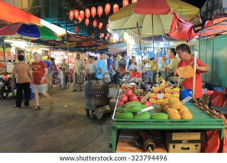 KUALA LUMPUR MALAYSIA - 24 MAY, 2014:Unidentified people shop at Chinatown. China town, also known as Petaling street is a popular tourist destination and has dozens of restaurants and food stalls.  - stock photo