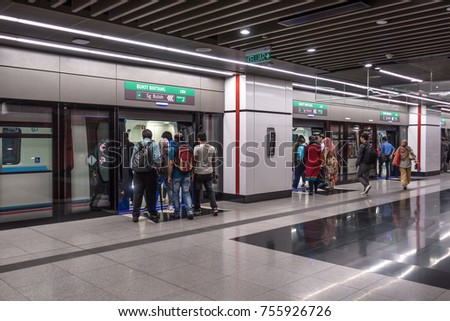 KUALA LUMPUR, MALAYSIA 9 NOVEMBER 2017 : Commuters on Mass Rapid Transit (MRT) train at Cochrane Station. MRT is the latest public transportation system. MRT is a transportation for future generation.