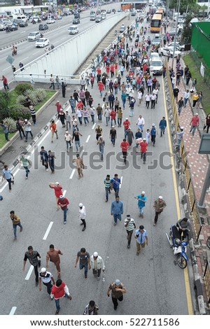 KUALA LUMPUR, MALAYSIA - NOVEMBER 25 2016: From a top view of an unknown protesters of Malaysian and Rohingya people in a peaceful rally march their way to Myanmar Embassy in Kuala Lumpur, Malaysia.